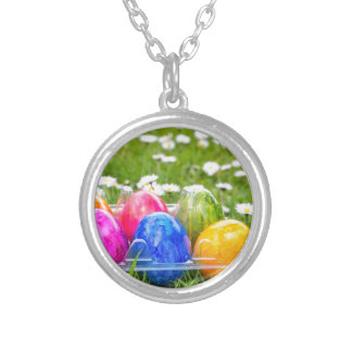 Colorful painted easter eggs in grass with daisies silver plated necklace