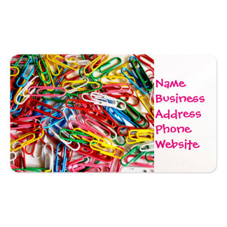 Colorful paper clips on white background. business card