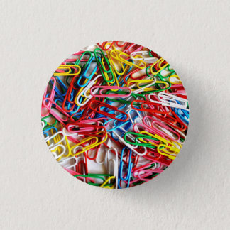 Colorful paper clips on white background. button