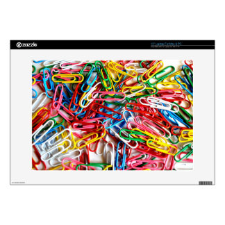 Colorful paper clips on white background. decals for laptops