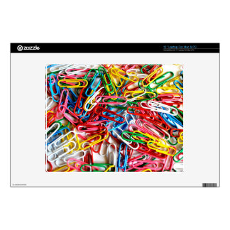 Colorful paper clips on white background. laptop decal