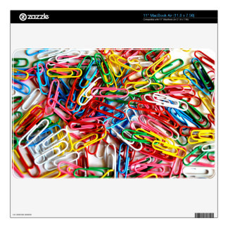 Colorful paper clips on white background. MacBook air decal