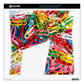 Colorful paper clips on white background. skin for xbox 360 s