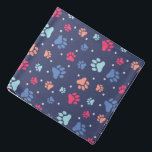 "Colorful Paw Prints on Navy Blue Canvas Bandana<br><div class=""desc"">Darling paw prints in a variety of colors,  set over a navy blue background. Your pet will look gooood sporting this design!</div>"