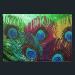 "Colorful Peacock Placemat<br><div class=""desc"">A rainbow of peacock feathers against a green background.  The design sparkles to life.</div>"