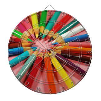 Colorful pencil crayons in a circle dartboard with darts