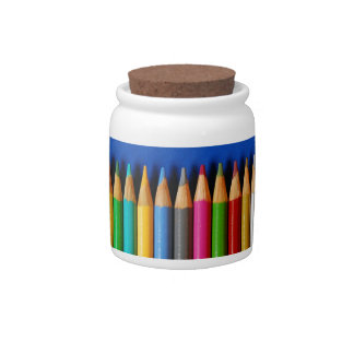 Colorful pencil crayons on blue background candy dish