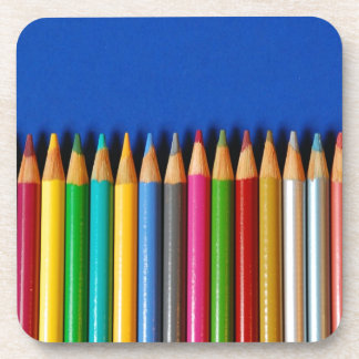 Colorful pencil crayons on blue background drink coasters