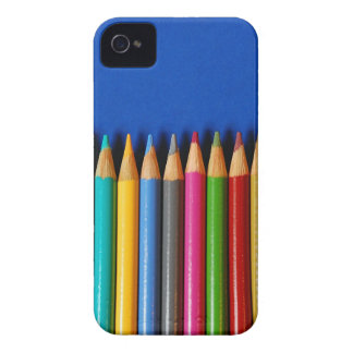 Colorful pencil crayons on blue background iPhone 4 case