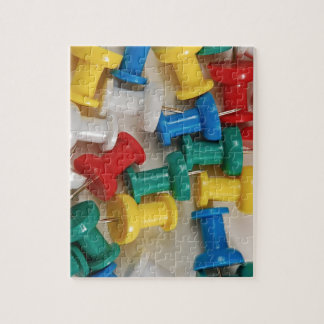 Colorful plastic push pins puzzle