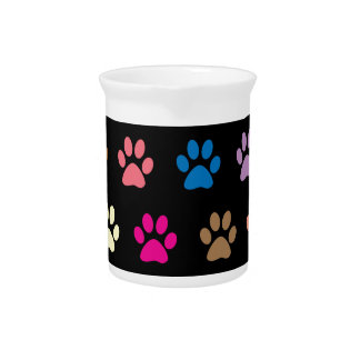 Colorful puppy paw prints on black drink pitcher
