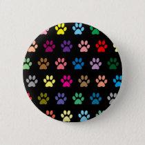 Colorful puppy paw prints on black pinback button