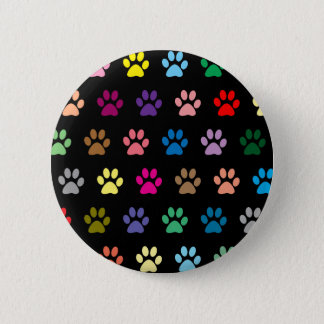 Colorful puppy paw prints on black pinback button
