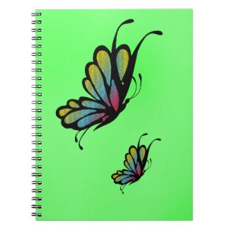 Colorful Rainbow Butterflies on Green Notebook