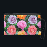 """Colorful Roses Wristlet<br><div class=""""desc"""">A pattern of brightly colored rose blooms against a pattern of dark green rose leaves.</div>"""