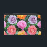 "Colorful Roses Wristlet<br><div class=""desc"">A pattern of brightly colored rose blooms against a pattern of dark green rose leaves.</div>"