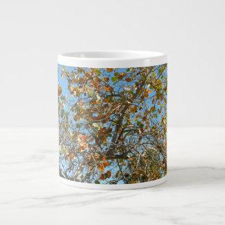 Colorful seagrape tree against blue florida sky large coffee mug