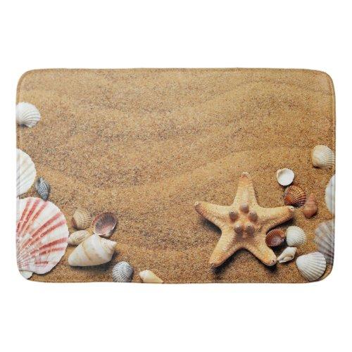 Colorful seashells on the sand bath mat