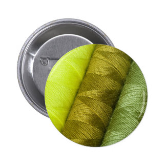 Colorful sewing threads texture button