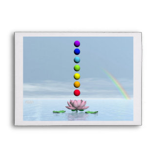 Colorful spheres for chakras upon beautiful lily f envelope