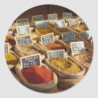 Colorful spices in jute bags at the local market classic round sticker