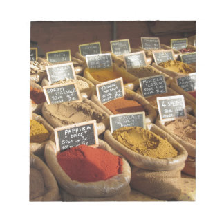Colorful spices in jute bags at the local market notepad