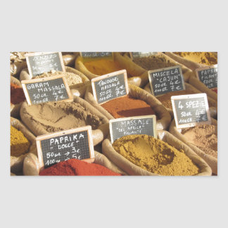 Colorful spices in jute bags at the local market rectangular sticker