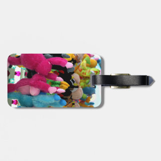 colorful stuffed animals abstract at fair midway tag for luggage