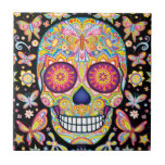 """Colorful Sugar Skull Ceramic Tile<br><div class=""""desc"""">This Colorful Sugar Skull Ceramic Tile features a colorful psychedelic sugar skull celebrating Mexico&#39;s Day of the Dead,  or Dia de los Muertos. The funky design for this Sugar Skull Colorful Day of the Dead Skull Ceramic Tile is based on the artwork of Thaneeya McArdle.</div>"""