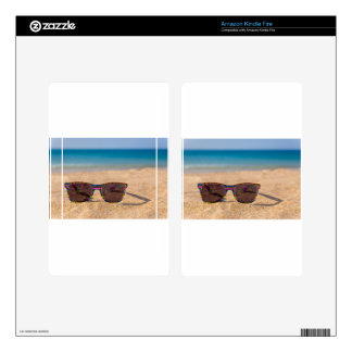 Colorful sunglasses lying on beach.JPG Skins For Kindle Fire