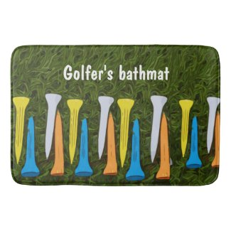 Colorful tees are on green grass for golfer bath mat