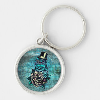 Colorful textured owl illustration on teal base. keychain