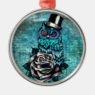 Colorful textured owl illustration on teal base. metal ornament