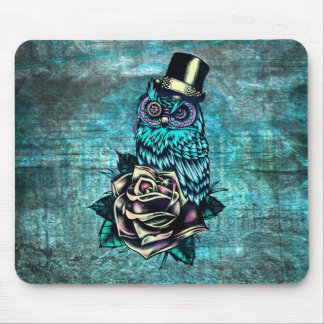 Colorful textured owl illustration on teal base. mouse pad