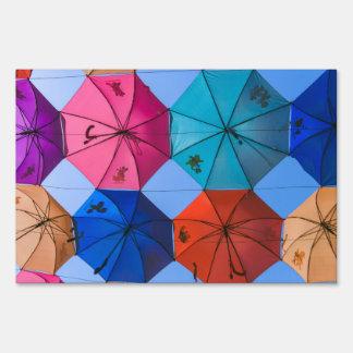 Colorful umbrellas sign