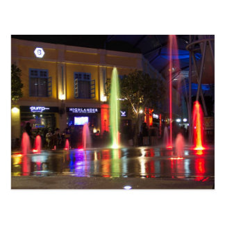 Colorful water jets at Clarke Quay Postcard