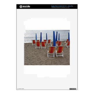 Colorful wooden chairs at sand beach iPad 3 decals