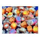 Colorful wrapped taffy candy postcard