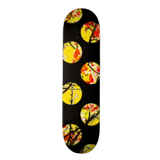 Colorful yellow circles on black skateboard deck