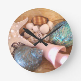 colorfull multiple sea shell arrangement round clock