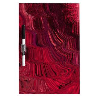 Colorido púrpura rosado que fluye del extracto pizarra blanca