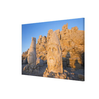 Colossal head statues of Gods guarding the Stretched Canvas Prints