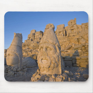 Colossal head statues of Gods guarding the Mouse Pad