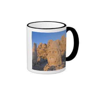Colossal head statues of Gods guarding the Ringer Coffee Mug