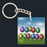 "Coloured Happy Easter Eggs - Acrylic Keychain<br><div class=""desc"">A colourful easter illustration: Metalic style coloured Easter eggs with &quot;Happy Easter&quot; lettering.</div>"