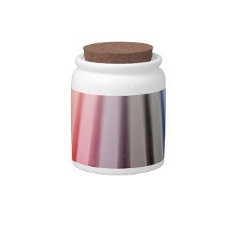 Coloured pencils in a rainbow candy jar
