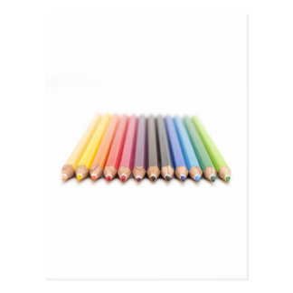 Coloured pencils in a rainbow postcard