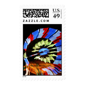 Colourful fair ride neon light photograph postage stamp