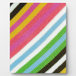 Colourful knitted background display plaques