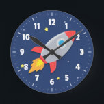 "Colourful Rocket Ship, Outer Space, For Kids Room Round Clock<br><div class=""desc"">Add a sense of adventure for a kids room,  especially boys room with this cute and colourful clock that has a rocket ship blasting off into a galaxy of stars across the dark blue background. A fun centrepiece with easy to read white numbers for a clock face.</div>"